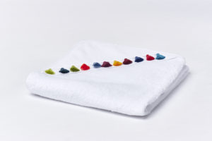 Baby towel with pompons