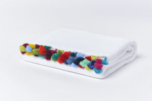 Bath mat with colorful pompons