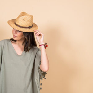 Khaki poncho with pompons